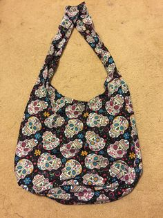 A personal favorite from my Etsy shop https://www.etsy.com/listing/526548333/day-of-the-dead-hobo-bag