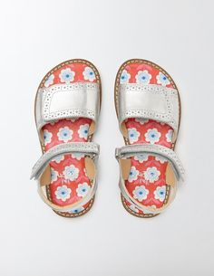 Made for sunny days, these sandals have easy touch-and-close fastenings and padded leather in-socks that are great for active adventurers. In bright and bold leather, they're durable enough to withstand playtime. Pretty lining and cut-out detailing make them perfect for everyday wear or special occasions.