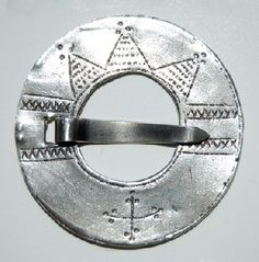 Silver brooch. D 45 mm. Early rõngassõle (sõõrsõle) type a simple ornament. A copy of the Estonian History Museum's collections (A593: 50). The original bronze, found in archaeological excavations in the church yard Viru-Nigula 1990th a. Estonia reached rõngassõlgede frontrunners probably German conquerors through 13 century. Such worn by both men and women