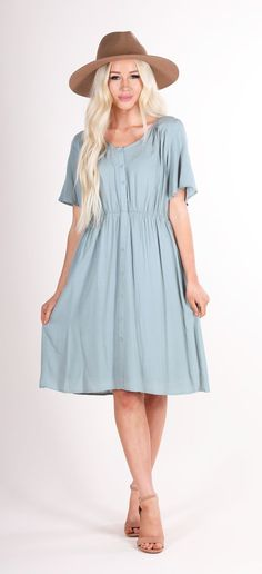 455de7eb262 A very feminine sage knee length dress with a slight V-neck and buttons on