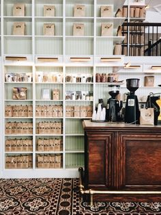 Shelves around service area Boutique Interior, Shop Interior Design, Cafe Design, Retail Design, Coffee Shop Aesthetic, Apothecary Decor, Coffee Shop Design, Coffee And Books, Coffee Coffee