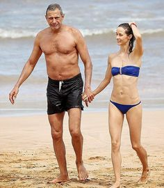 (20 PHOTOS and 2 Videos) Blushing bride-to-be, the actor, Jeff Goldblum looked happy as he wandered around the beach at Hawaii, USA on Tuesday, July 15, 2014.
