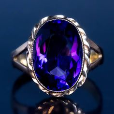 Siberian Amethyst, Rose Gold, Antique Russian Ring. Made in Moscow between 1899 and 1908 A 14K rose gold ring features a bezel-set oval Siberian amethyst of a deep royal purple color.