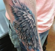 Blue Mens Angel Wing Tattoos On Outer Forearm