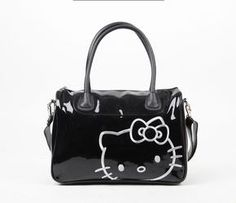 47af014b839 Planning a girls getaway or a gym workout  Pack your gear into this chic bag!  Its glossy black design showcases an embroidered Hello Kitty motif in  silver ...