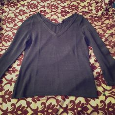 Eileen Fisher Knit V Neck Sweater Great condition! Just recently dry cleaned. Made of Italian yarn. The color is gray with a purple tint Eileen Fisher Sweaters V-Necks