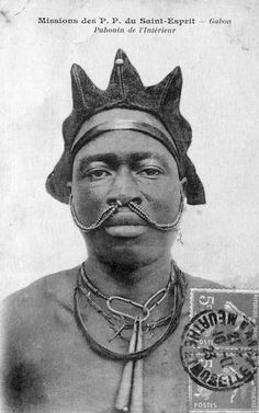 Africa | Pahouin man with nose jewellery and braided hair.  Gabon; ca. 1923 || Scanned postcard.