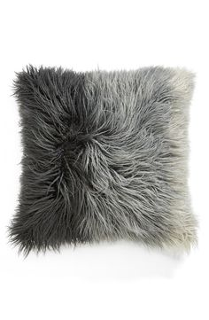 Adding this ombré faux fur accent pillow to the living room.