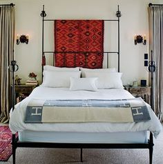 Love the idea of the kilim hanging from the headboard