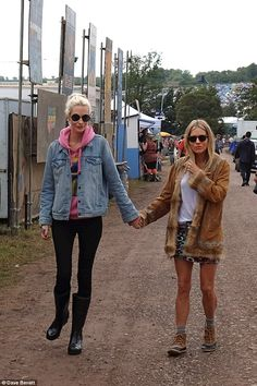 c8a096715b4 Sienna Miller and Poppy Delevingne as seen at Glastonbury in the SOREL Joan  Rain Wedge Tall