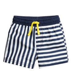 Dark blue/striped. Swim shorts with a printed pattern. Elasticized drawstring waistband and mock fly. Soft mesh liner shorts.