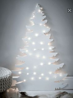 a white Christmas tree silhouette wall art with lights is great for a minimalist space or a Nordic one Christmas Tree Silhouette, Wall Christmas Tree, Christmas Tree Design, Decorating With Christmas Lights, Beautiful Christmas Trees, Magical Christmas, Noel Christmas, White Christmas, Christmas Tree Decorations