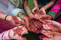 Indian bride and bridesmaids showing their mehndi art before wedding reception http://www.maharaniweddings.com/gallery/photo/92754 @makingthemoment