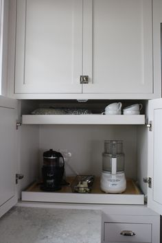 coffee station with pull out drawers right above the counter. easy fixin in the morning.
