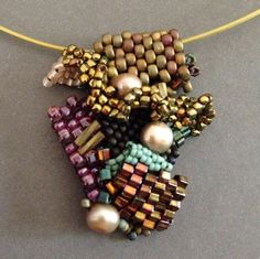 Freeform seed bead woven pendant by Beth Stone
