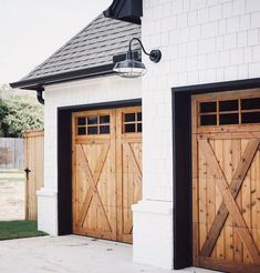 Home Renovation Garage wood rustic farmhouse Garage doors, white siding, black roof Faux Wood Garage Door Diy, Modern Garage Doors, Wood Garage Doors, Garage Door Design, Black Garage Doors, Black Doors, Front Doors, Garage Door Trim, Carriage Garage Doors