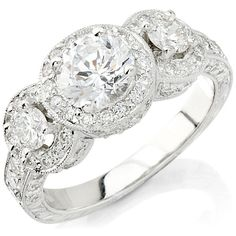 Love the Vintage look and think it would make a great accessory! in my dreams, 18K white gold, 3 stones