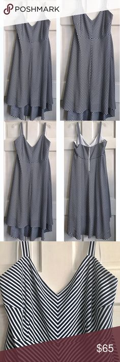 Striped A-Line Dress Taylor Woman / Striped A-Line Dress   US Plus Size 24W - Navy & white striped chevron pattern - Sleeveless / Silver back zipper - High/Low hemline - Fitted bodice with A-line skirt that flows from waist - Fully lined - 97% Polyester, 3% Spandex / Lining 100% Polyester  ✅ NWOT. Brand new- worn briefly for photos. ✅ NO trades / NO low-balling ✅ List price is fair and highly discounted✌️ Taylor Woman Dresses