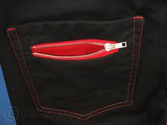 CRAIG are black jeans with a small zipper pocket in the left hip pocket.