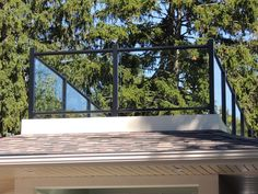 Glass railing on top of roof top deck