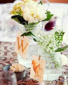 Jars of hydrangea, peonies, baby's breath, and salal impart a homemade feel.