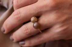 &-Collection ring with a diamond pavé setting bowl in champagne and a brown moonstone bowl.