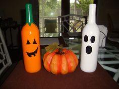 Tover wijnflessen om tot Halloween decoratie