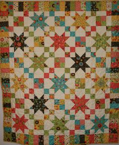 I like the variation in the stars. I could use my autumn colors by Sandy Gervais and make a pretty fall quilt. Would just need to find a cream background.