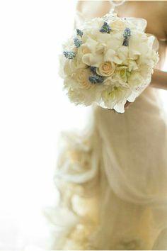 Bride's Bouquet: White Peonies, White Fringed Tulips, White Freesia, White Ranunculus, Cream Roses, White Gardenias & Blue Grape Muscari Hyacinth