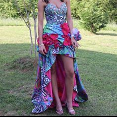 Jovani dress size 0 Giovanni dress size 0 only worn once to prom still in good condition had it taken in but can be let back out high low dress Jovani Dresses