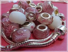 'Over 30 European Style Beads plus Two Bracelets' is going up for auction at  1pm Sat, Aug 11 with a starting bid of $5.