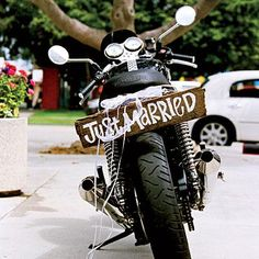 "'Just Married' Getaway Sign | A wooden ""Just Married"" sign adorns the couple's getaway motorcycle. 