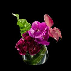 Splendor - Beautiful ranunculus coupled with magenta pink vanda orchids and calla lilies, designed to inspire affection.