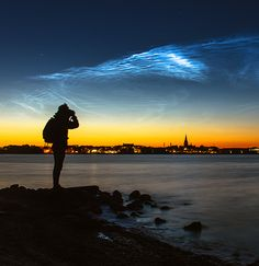 June 13th, observers in more than half a dozen European countries witnessed a brilliant apparition of noctilucent clouds. Ruslan Merzlyakov sends this picture from Nykøbing Mors, Denmark.    Noctilucent clouds are a space weather phenomenon. They are seeded by meteoroids and hover 83 km above Earth's surface at the threshold of space.  pinned by haw-creek.com.