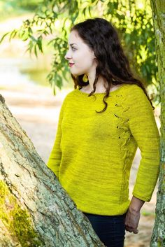 """""""Lemon Pie"""" is a cheerful pullover with a wide lace pattern cleverly incorporated into the raglan lines and continuing onto the back in an unusual, optically slimming way. Constructed top-down entirely seamless with ¾ sleeves, a relaxed boat neck, and just enough ease to be considered comfortable but not shapeless, this sweater is predestined to become a favorite!With its lace panels resembling rows of dancing lemon pie wedges, this sweater looks especially cheerful when worked in a fresh…"""