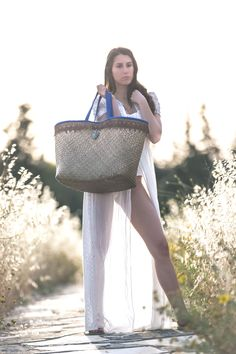Straw Bag with Brown Embroidered and Blue Leather Handles.This straw bag is perfect for your vacation getaways and city escapes. Calling all the beach lovers! Leather Bags, Leather Handle, Straw Tote, Beach Bags, Gold Pendant, Lovers, Holidays, Tote Bag, Vacation