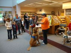 Paws for reading | Volunteer Del Cleek introduces her reader dog Toby to visitors at the DeMotte Spring Festival. Toby has worked at the library in the past offering a chance for children to get a chance to read to a dog.