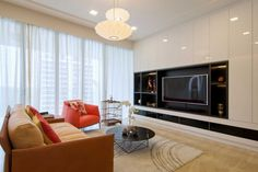 Elegant Contemporary Apartment in Singapore This elegant apartment is a private residence located in Singapore. Zeitgenössisches Apartment, Apartment Design, Tv Wall Design, House Design, Best Home Theater, Contemporary Apartment, Designer, Home Goods, Home Improvement