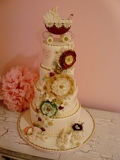 Vintage Baby Shower Cake - Beautiful! Maybe downsize it a tier though... Love the decorations <3