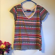 Nikita patterned t-shirt Colorful and casual t-shirt.  Says L but I'd definitely say it is medium-small.  Used but still in good condition. Nikita Tops Tees - Short Sleeve