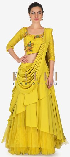 Buy Online from the link below. We ship worldwide (Free Shipping over US$100)  Click Anywhere to Tag Corn mustard multi layer lehenga with raw silk blouse and pre stitch dupatta only on Kalki Corn mustard lehenga featuring in satin and net multi layer.Matched with raw silk blouse in cut dana and sequin embroidery.It comes with fancy pre stitched pallav.