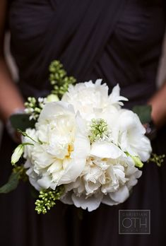 A white posy made up of peonies, white lilac, and freesia created by New York City-based florist Belle Fleur.
