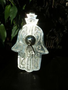 Re create your Moroccan seaside retreat. Silver hands of Fatima to ward off the evil eye. These can be found online http://www.maroque.co.uk/catalog.aspx?p=01027&n=all