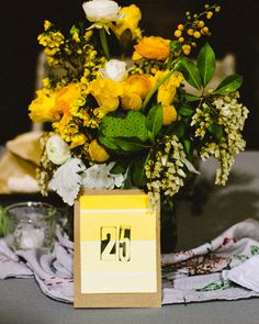 This cute and simple table number was rubber-stamped onto a bright yellow paint chip.