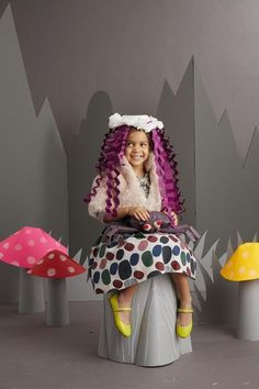 A sweet disguise for a proper little lady: Her wig and cap are made from accordion-folded paper, a paper bowl, and coffee filters.      	Click here to get the directions to make the Little Miss Muffet costume.