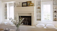 love this. pretty fireplace with window seats and glass shelves but to much white lol need darker colors hide the dirt marks from kids lol