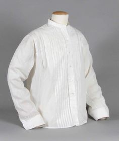 Woman's cotton shirtwaist, c. 1900. The shirtwaist, based on men's shirts, appeared in women's fashion in the 1890s. The perfect complement to the new tailored suit and separates, it was available at every price, and soon was made with feminine touches like lace and embroidery. The shirtwaist was worn by college girls, office and factory workers, and for sports.