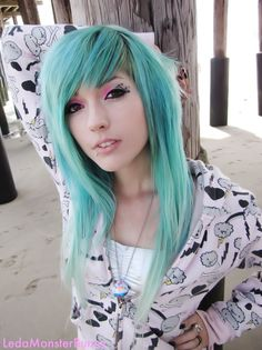 leda muir with turquoise hair and the cutest hoodie ever