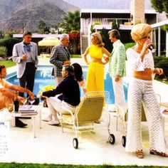 A poolside party at a desert house, designed by Richard Neutra for Edgar J. Kaufmann, in Palm Springs, January 1970. Featured in the group are: industrial designer Raymond Loewy (1893 - 1986, centre, standing), Nelda Linsk (in yellow), wife of art dealer Joseph Linsk, and Helen Dzo Dzo (second from right).   Artist: Slim Aarons