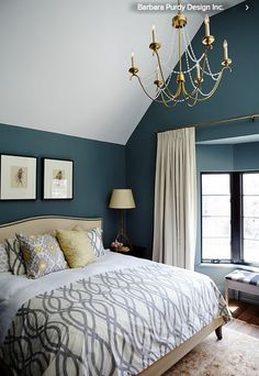 Paint your bedroom a rich color. A can of paint is not a major investment, but changing the wall color of a room can have a huge impact. This fall try a rich blue-gray in the bedroom for an opulent look.